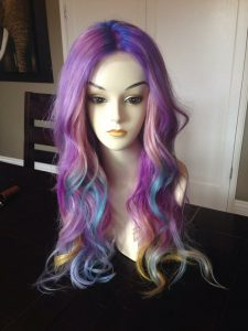 Gardea's first wig, the unicorn rainbow wig.